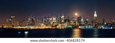 Moon rise over midtown Manhattan with city skyline at night - stock photo