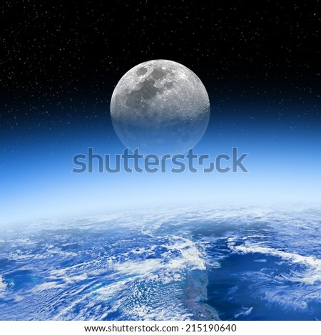 Moon rising behind the Earth's atmosphere. Small stars are in the background. Elements of this image furnished by NASA. - stock photo