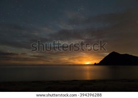 Moon rising in Abel Tasman National Park, New Zealand - stock photo