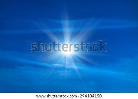 Moon shining on blue night sky with many stars - stock photo