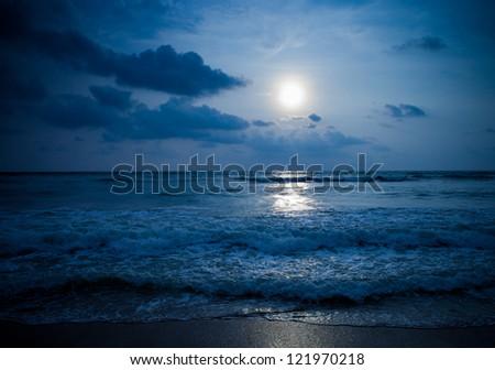 Moon under ocean - stock photo