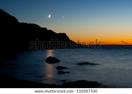 Moon, Venus and Mars at Torro del Porticciolo close to Alghero - stock photo