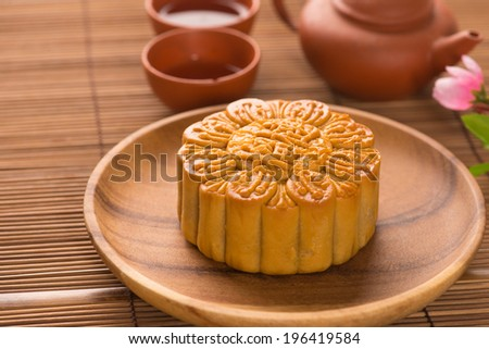 Mooncake and tea,Chinese mid autumn festival food.  - stock photo