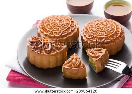 Mooncake and tea,Chinese mid autumn festival food. a fork and a piece of cake. the idea of appetite. - stock photo