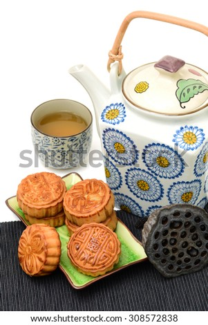 Mooncake and tea,Chinese mid autumn festival food on white background
