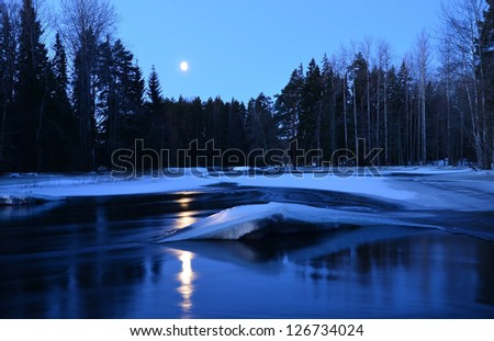 Moonlight on the river in winter - stock photo