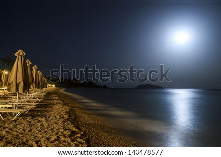 moonlight over the sea and the beach