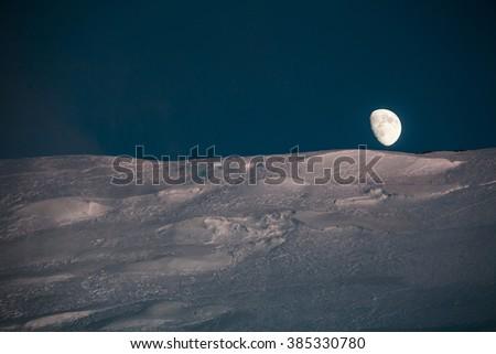 Moonrise in mountains - stock photo