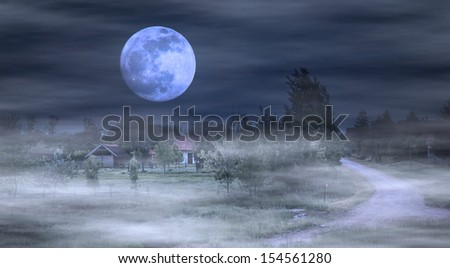 Moonrise over farm and dark foggy night - stock photo