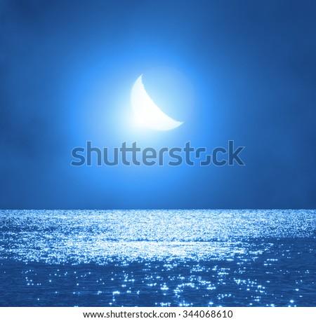 Moonrise over ocean/sea horizon. No elements of NASA or other third party. - stock photo