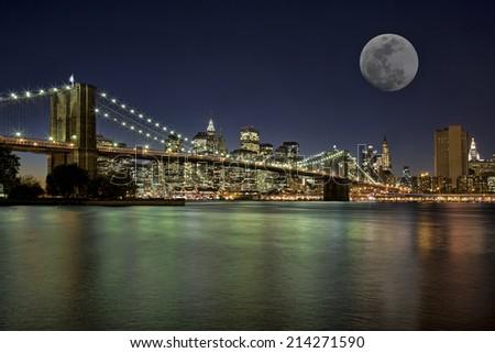Moonrise over the Brooklyn Bridge New York City New York USA - stock photo