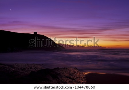 Moonrise over the Tagle beach (Bay of Biscay,Spain) - stock photo