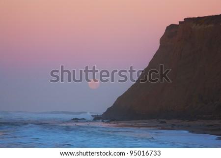 Moonset at sunrise at Half Moon Bay, California - stock photo