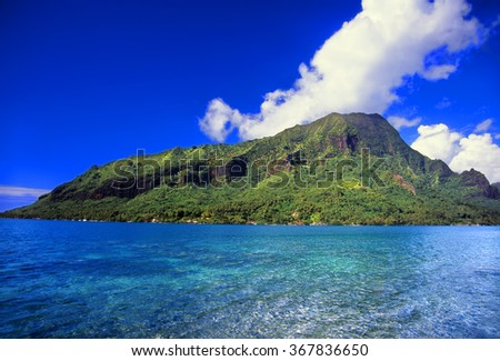 Moorea is a beautiful island covered in lush rainforests in French Polynesia - stock photo
