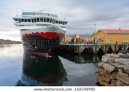 Moored big modern passenger ship. Rorvik, Norway - stock photo