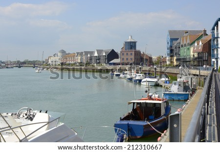 Moored boats along the River Arun at Littlehampton in West Sussex. England