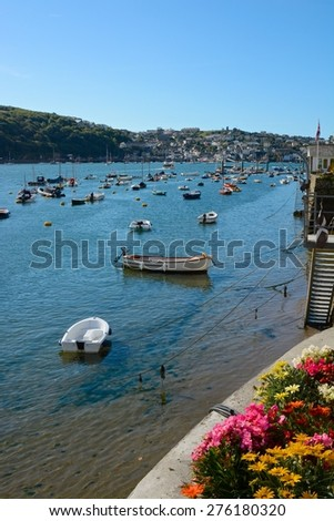 Moored boats on the River Fowey at Fowey, Cornwall, England - stock photo