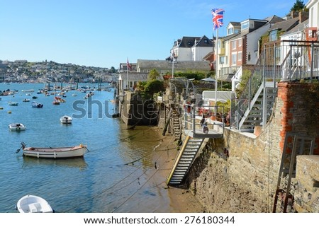 Moored boats on the River Fowey at Fowey, Cornwall, England. With Houses on river bank - stock photo