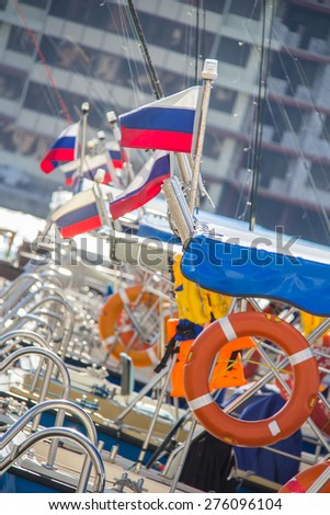 Moored boats with Russian flag