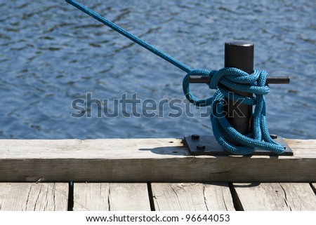 Mooring a Boat in the Harbor - stock photo