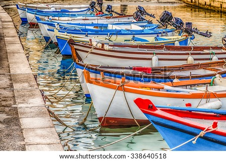 mooring boats in a bay of a medieval city on the Adriatic Sea in Italy