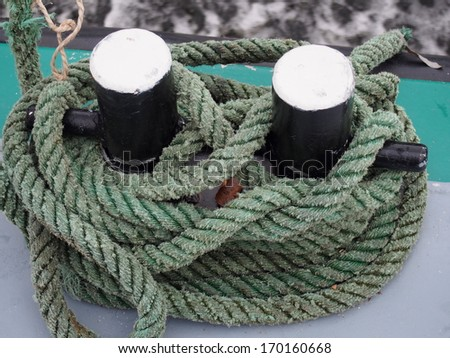 Mooring bollard and rope - stock photo