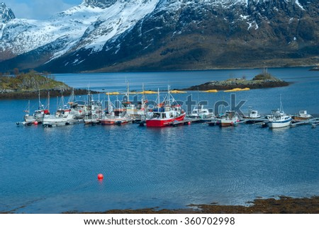 Mooring of boats on the lake in the mountains - stock photo