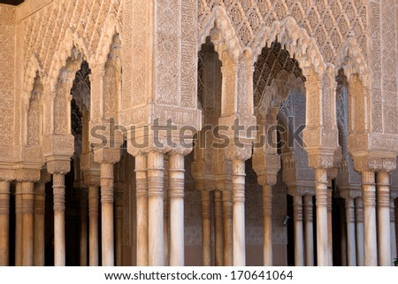 Moorish arches and columns of Alhambra harem in Granada, Spain - stock photo