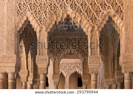 Moorish arches and columns of Alhambra harem in Granada, Spain - stock photo