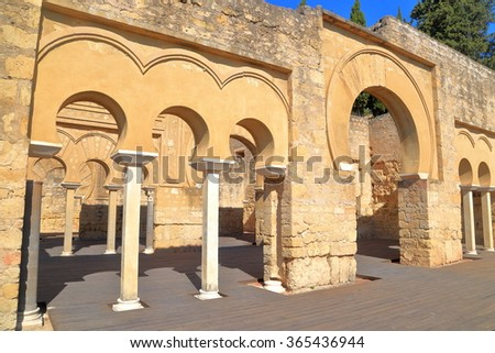 Moorish arches of the Upper Basilica building inside Medina Azahara (vast, fortified Arab Muslim medieval palace-city) near Cordoba, Andalusia, Spain