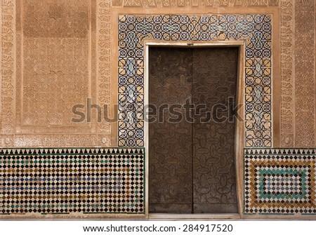 moorish ornate wall with door - stock photo