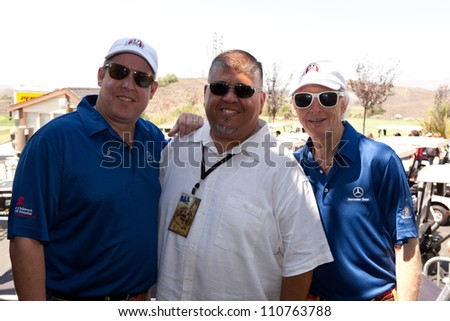MOORPARK - AUG 20: Scott Medlock, Guest, and Robby Krieger (L to R) attends Medlock Krieger Celebrity Golf Invitational & All Star Concert at Moorpark Country Club, August 20, 2012 in Moorpark, CA