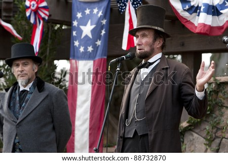 """MOORPARK, CA - NOV 13: """"Abraham Lincoln"""" and """"Jefferson Davis"""" at """"The Blue & The Gray"""" event on Nov 13, 2011 in Moorpark, CA. Its the largest Civil War reenactment in the West. - stock photo"""