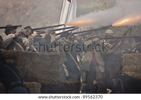 """MOORPARK, CA - NOV 13: """"Confederates"""" fire a volley at """"The Blue & The Gray"""" event Nov 13, 2011 Moorpark, CA. The largest Civil War reenactment in the West. - stock photo"""
