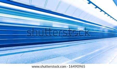 mooving train on platform in subway - stock photo
