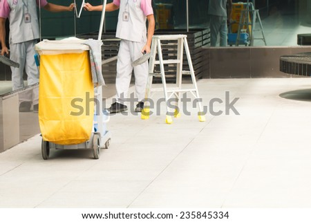Mop bucket with cleaner background - stock photo