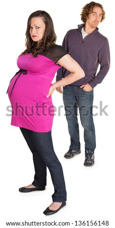 Moping pregnant woman with naive man with hands in pockets - stock photo