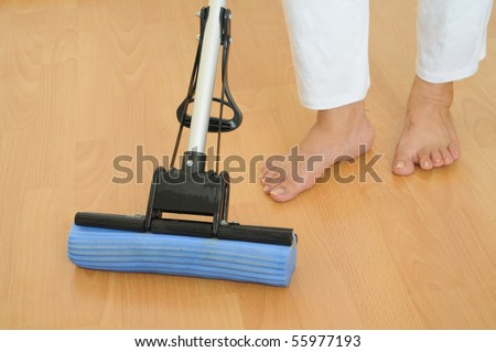Mopping The Floor With A Sponge Mop - stock photo
