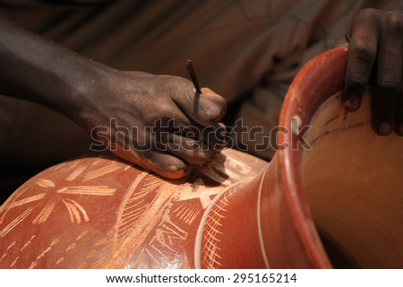 MOPTI, MALI, AFRICA - AUGUST, 26, 2011 Craftsman working ceramics - stock photo