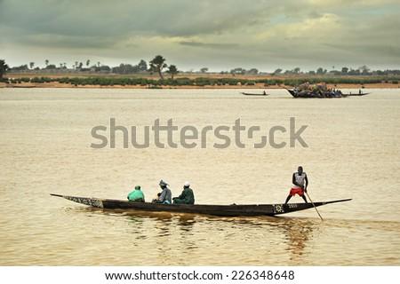 MOPTI, MALI, AFRICA - AUGUST, 26, 2011 Pinnace traveling through Niger - stock photo