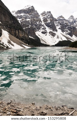 Moraine Lake in Spring, Rocky Mountains (Canada) - stock photo