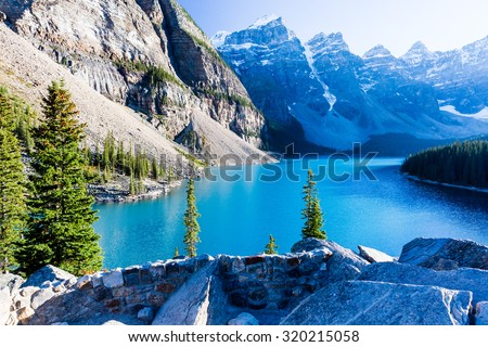 Moraine Lake is a glacially-fed lake in Banff National Park, 14 kilometres outside the Village of Lake Louise, Alberta, Canada. It is situated in the Valley of the Ten Peaks, at an elevation of 1,885m - stock photo