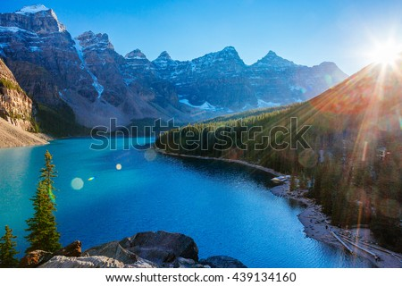 Moraine Lake is a glacially-fed lake in Banff National Park 14 km outside of Lake Louise, Alberta, Canada. It is situated in the Valley of the Ten Peaks, at an elevation of approximately 1885 m. - stock photo