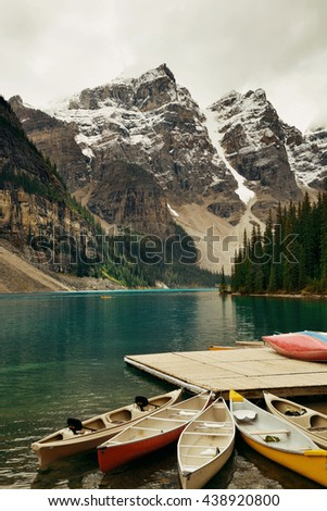 Moraine Lake with boat and snow mountain - stock photo