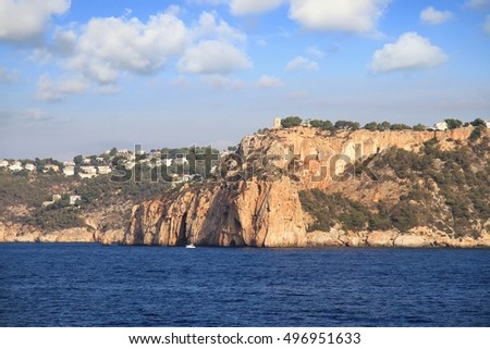 Moraira coast and cliffs and the Descubridor island in Spain