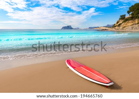 Moraira playa El Portet beach with paddle surfboard at Alicante Spain - stock photo