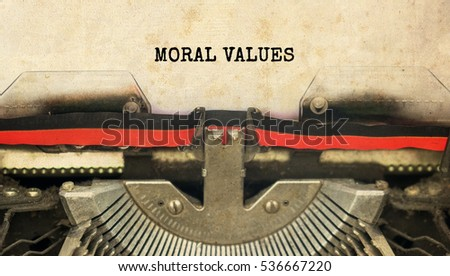 MORAL VALUES typed words on a vintage typewriter with vintage background
