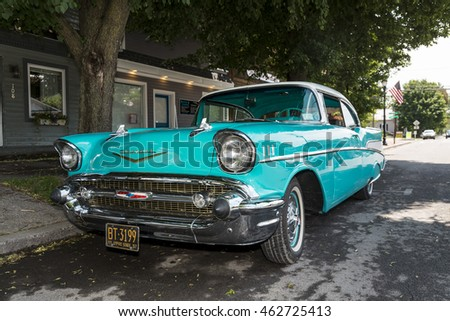 Moravia, New York - June 2016. Old classic aqua Chevy parked in the street.