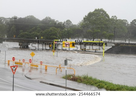 MORAYFIELD, AUSTRALIA - FEBRUARY 20: Cyclone Marcia causing flash flooding across roads on Feburay 20, 2015 in Morayfield, Australia - stock photo