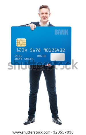 More opportunities. Handsome young business man holding big banking card. Isolated on white. - stock photo